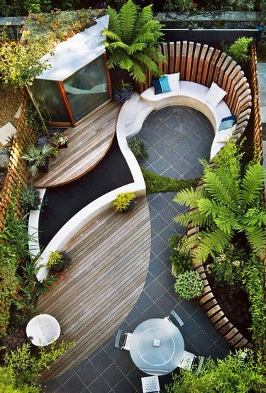 Curved decks with fountain and built-in seating