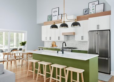 avocado green kitchen cabinets in lakehouse