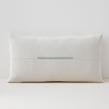 White pillow cover with blue accent