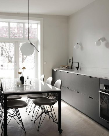contemporary kitchen with black cabinets and no hardware