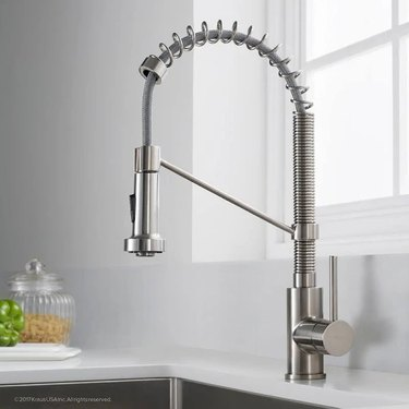 A chrome pull-out kitchen faucet