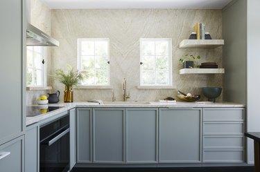 Blue craftsman kitchen with stone walls