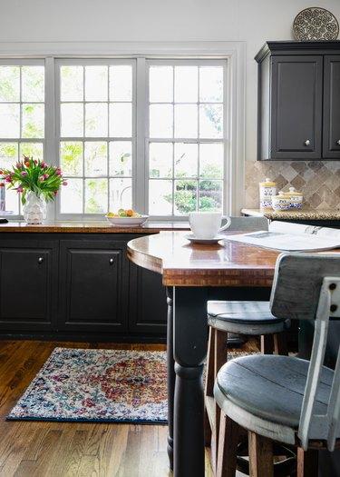 Modern craftsman kitchen with black cabinets