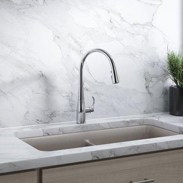 A touchless kitchen faucet