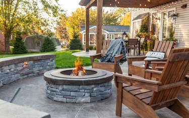 A concrete stamped patio paired with a wooden pergola