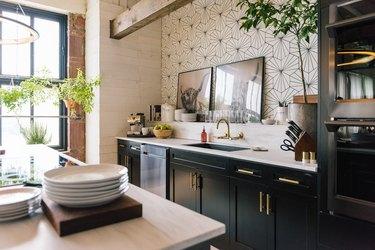 industrial kitchen in loft with patterned tile backsplash