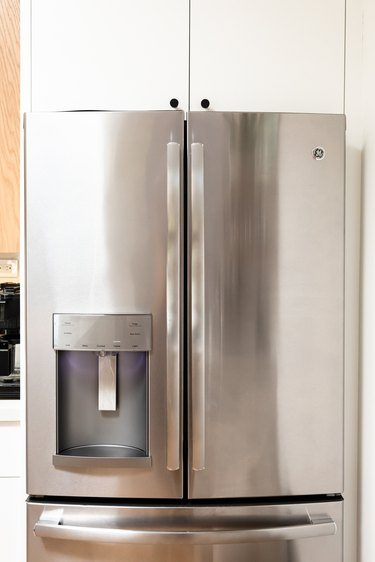 A stainless steel refrigerator with an ice maker