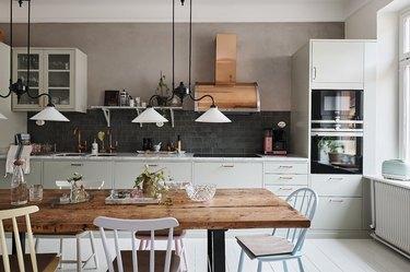 Scandinavian kitchen with black backsplash