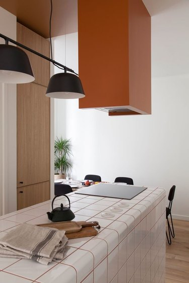 orange kitchen with tile countertop and orange grout