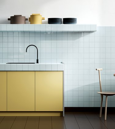 light blue tile backsplash, countertop, and shelving