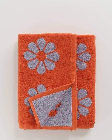 orange towel with flower pattern