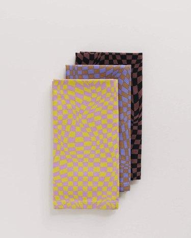 three cloths in wavy checkered patterns