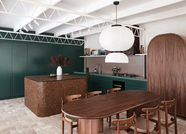 green kitchen with tile countertop island