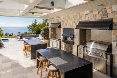 stone outdoor kitchen with double island