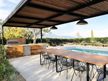 pool-side entertaining pergola with outdoor kitchen