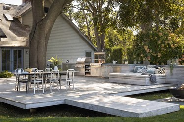 large outdoor patio with outdoor kitchen