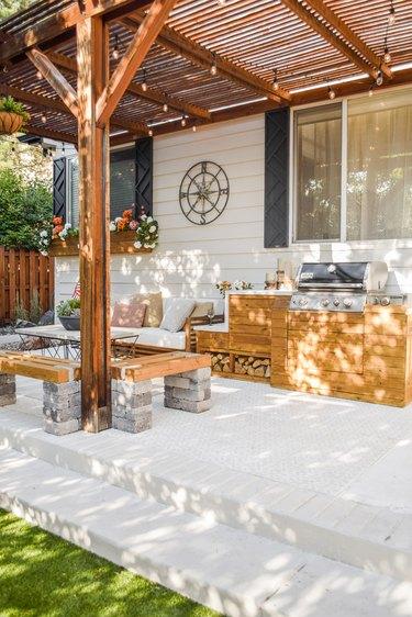 diy outdoor wooden kitchen with concrete-look waterfall countertop