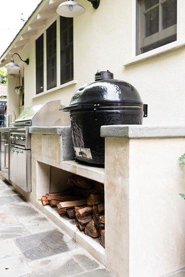 concrete outdoor kitchen with egg grill