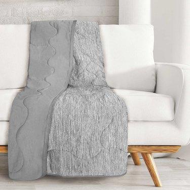 gray throw on white sofa