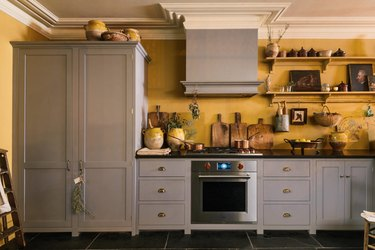 Kitchen with taupe cabinets and yellow walls.