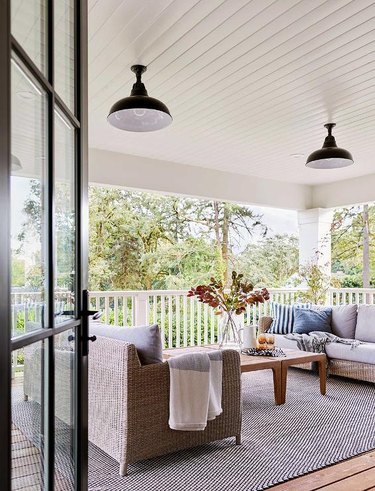 porch with couches, and black enamel lights
