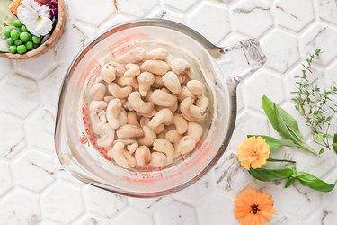 Soak cashews in boiling water