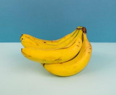 banana on half blue half light blue backdrop