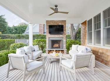 farmhouse porch with fireplace and TV