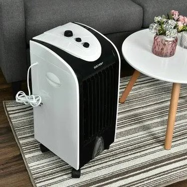 A portable evaporative cooler in a living room