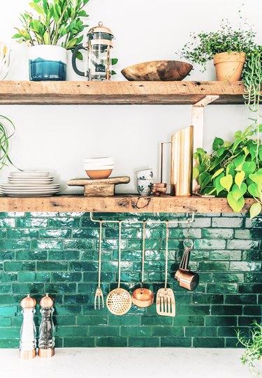 green subway tile backsplash in bohemian kitchen