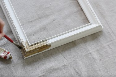 Painting picture frame with gold gilding wax