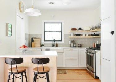 modern kitchen with gray subway tile backsplash