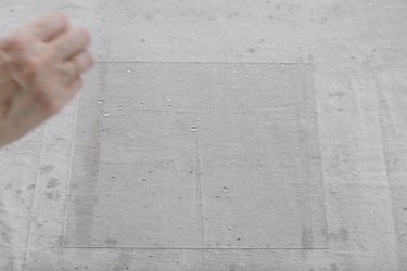 Flicking droplets of white vinegar onto glass
