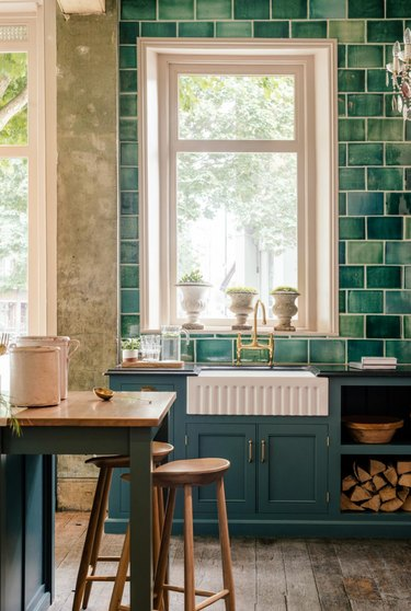 green subway tile in traditional kitchen with window