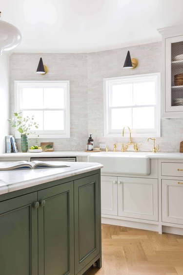 green and white kitchen with subway tile backsplash