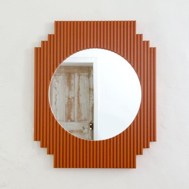 fluted mirror in ochre color