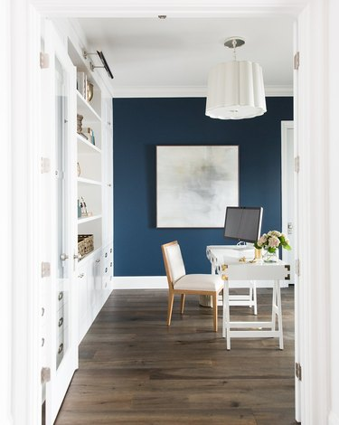 home office with navy blue accent wall