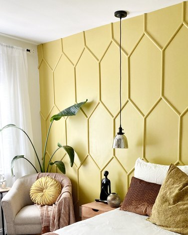 yellow accent wall in guest bedroom