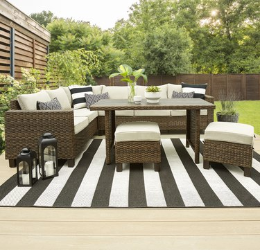 Outdoor wicker sectional set with light cushions