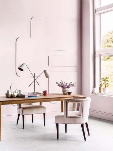 modern office with pastel pink walls