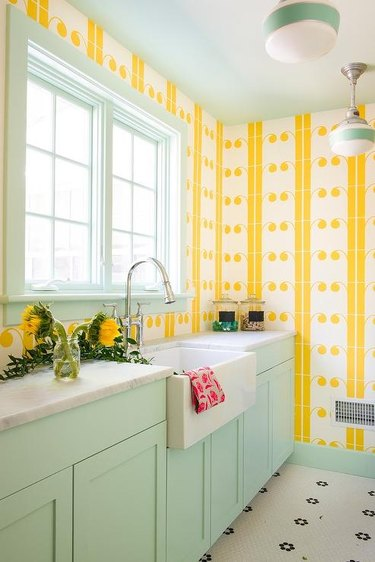 mint green and yellow laundry room