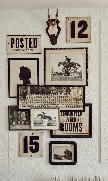 layered gallery wall of black and white vintage wall art