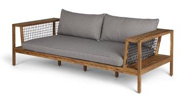 Grey outdoor sofa with dark wood