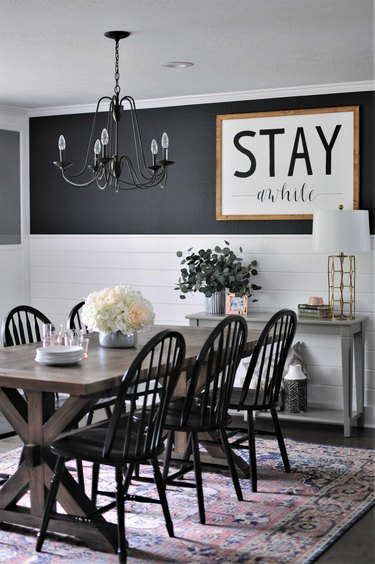 black and white farmhouse dining room with sign