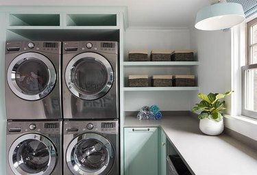 mint green laundry room with grey countertops