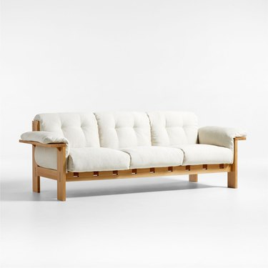 wood sofa with white linen upholstery