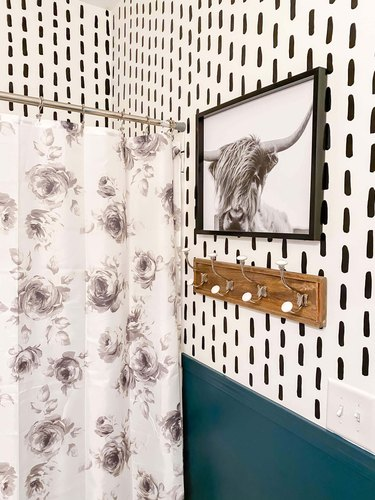 bathroom with black and white photo and modern wallpaper