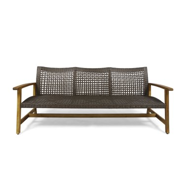 Wicker and wood outdoor couch without cushions