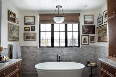 bathroom with vintage artwork gallery wall