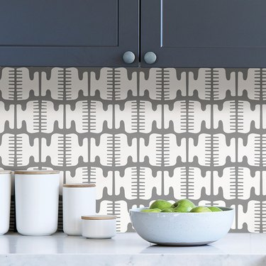 blue-gray kitchen with gray-and-white patterned backplash